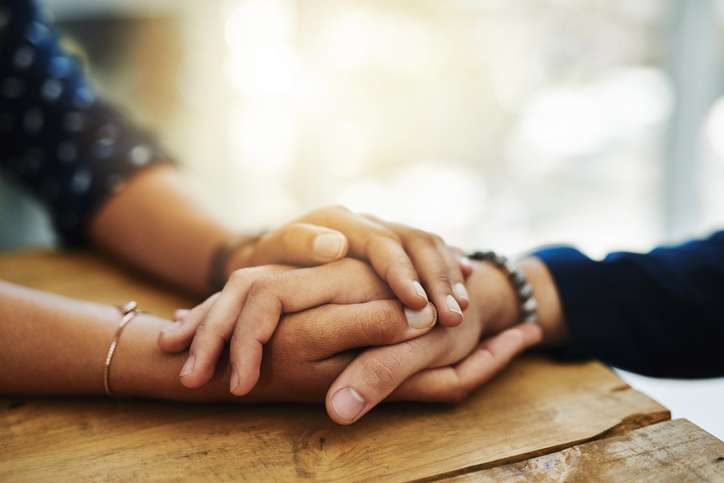 mom holding daughter's hand mental illness