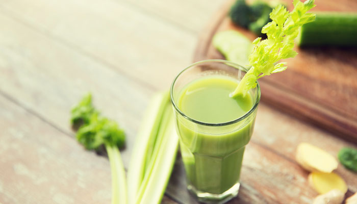 Glass of celery juice on wooden table; what are the health benefits?