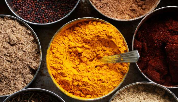 Metal bowls of spices, using turmeric as an anti-inflammatory