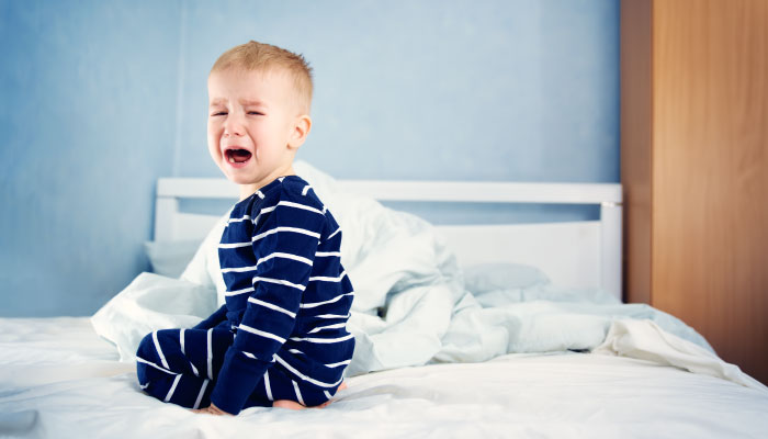 Crying, coughing child on his bed, is it pertussis, croup or RSV?