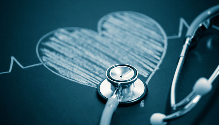 Stethoscope on a chalkboard heart, know heart attack symptoms