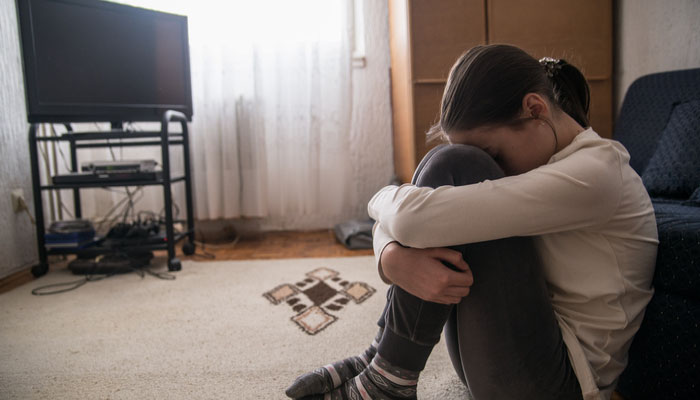 children coping with tragedy while watching TV