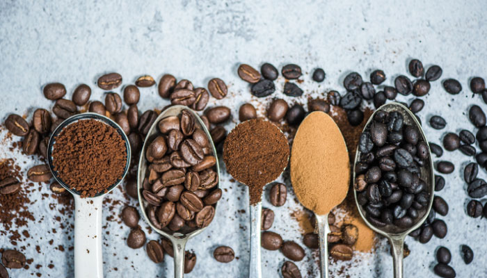 Spoons filled with ground coffee and coffee beans, is caffeine bad?