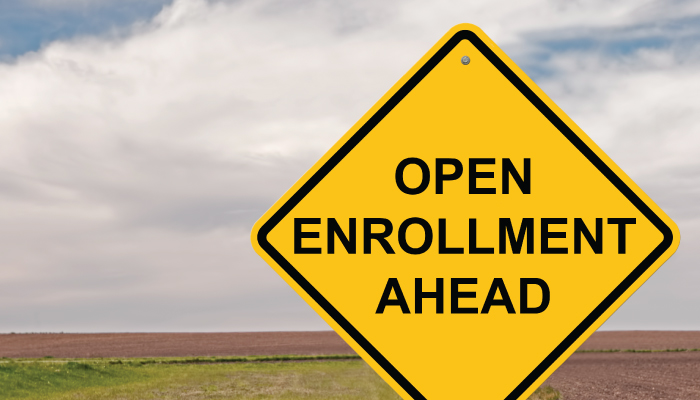 Open enrollment on traffic sign on open highway